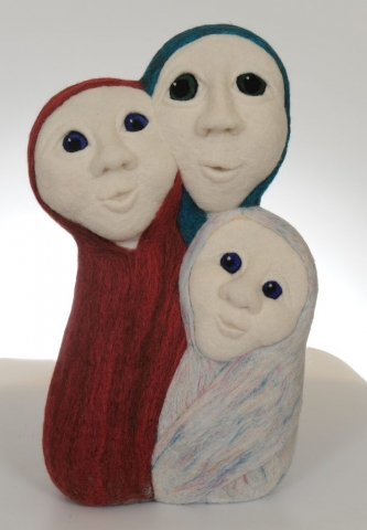 Felted sculpture depicting a maiden, mother and crone