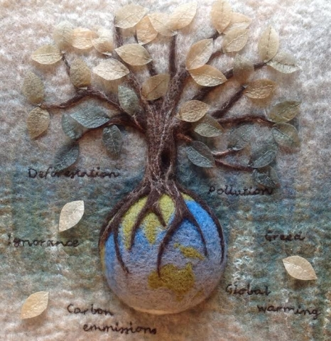 Textile art - felted tree with silk paper leaves, growing  out of the earth. Depicting the destruction of the world from global warming, carbon emissions, pollution and deforestation.