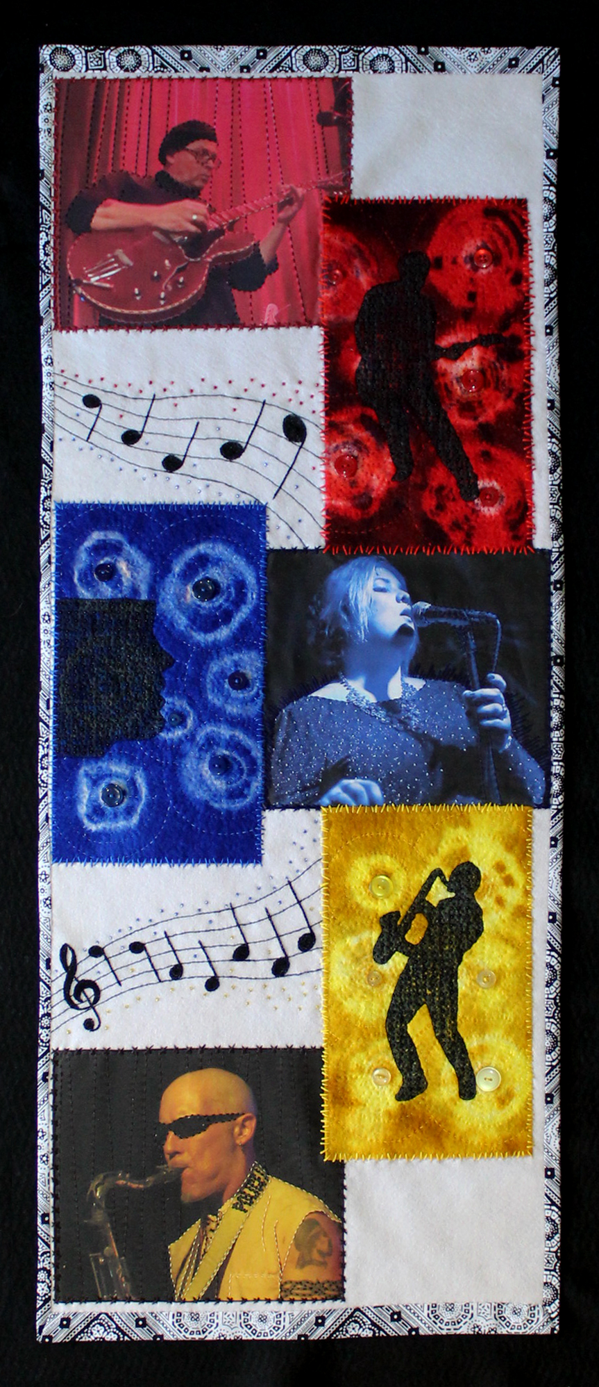 Detail of textile art hanging, embroidered and felted depicting jazz band.