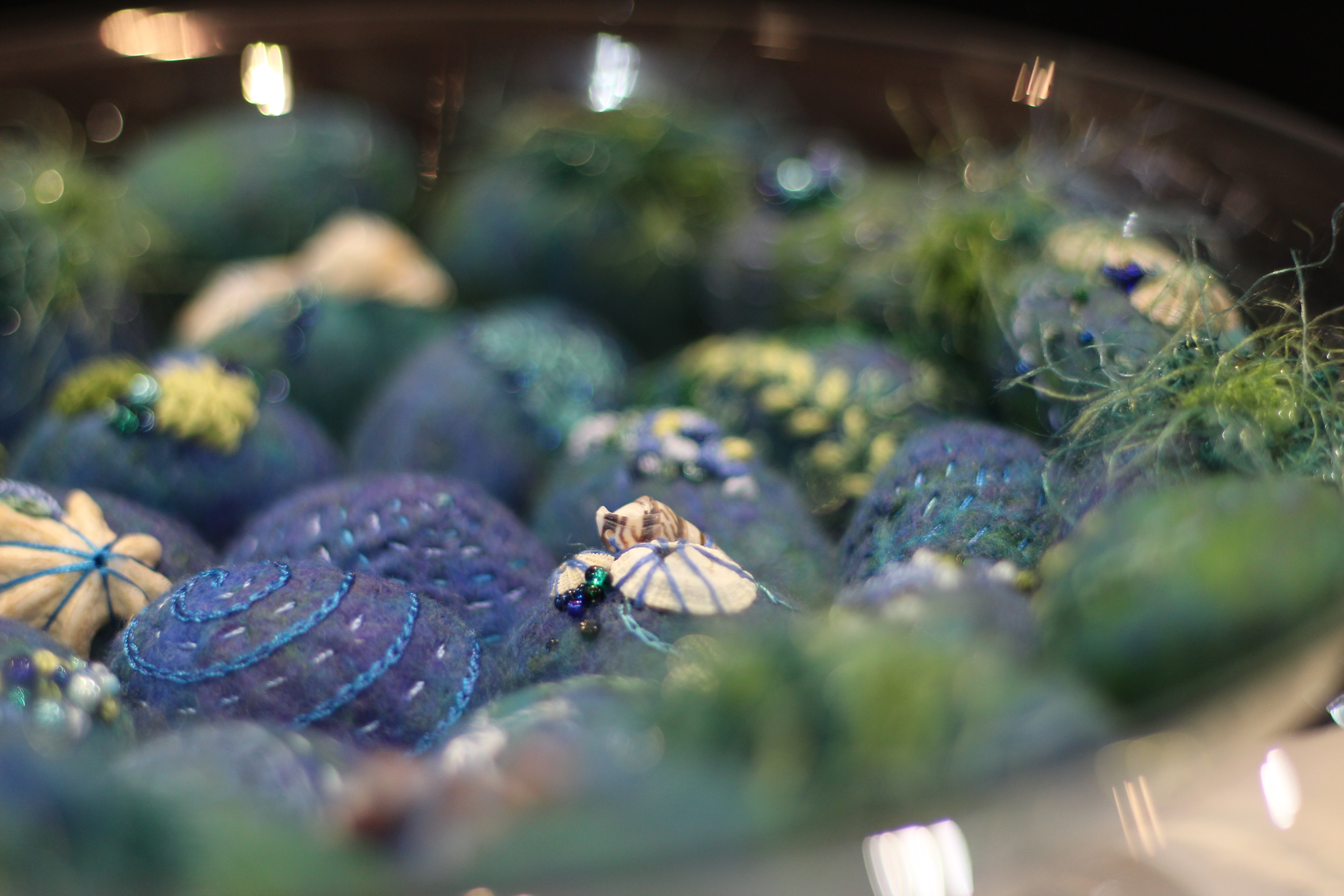 Detail of Tidal Pool sculptural work. Glass bowl with felted embroidered pebbles.